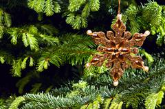 star shape christmas ornament in gold - stock photo