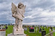Angel under storm clouds Stock Photos