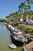 Boats on canal at Narbonne in France - stock photo