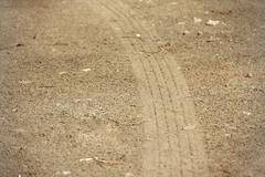 Curve tire tracks on soil Stock Photos