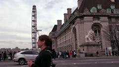 Lion at the end of Westminster Bridge with London Eye, London, England Stock Footage