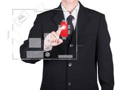 Businessman press to floor plan Stock Photos