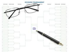 division tournament table with pen & eyeglasses - stock photo