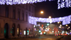 Movement of cars down the street with festive illumination, bokeh Stock Footage