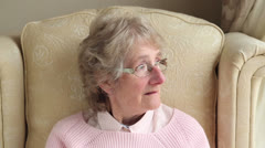 Happy senior woman turns to camera and smiles Stock Footage