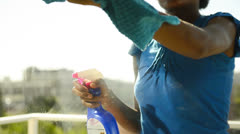 Maid cleaning windows - stock footage