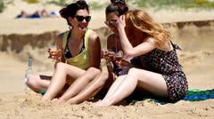 Girls having fun on beach Stock Footage