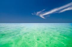 Crystal clear green indian ocean Stock Photos