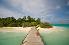 jetty that leads to a beautiful empty island - stock photo