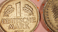 Stock Video Footage of Money Euro bank notes with Deutsche Mark coins