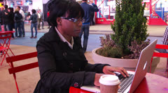 Woman Using Laptop in Timesquare at Night Stock Footage