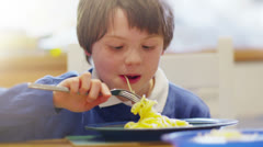 Cute little boy eating a plate of spaghetti Stock Footage