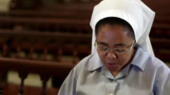 People and religion, catholic sister praying in church during mass - stock footage