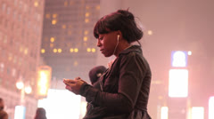 Woman in Timesquare Listening to Music - Profile Shot Stock Footage