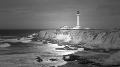 Beautiful California Pacific Ocean coast with historic lighthouse BW HD 5823. Stock Footage