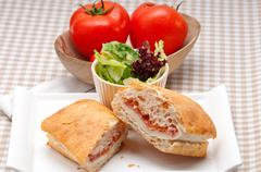ciabatta panini sandwich with parma ham and tomato - stock photo