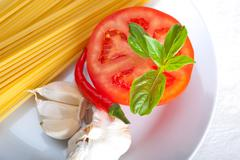 italian spaghetti pasta tomato ingredients - stock photo
