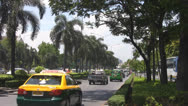 Stock Video Footage of Traffic on a Palm Tree Lined Carriageway p157