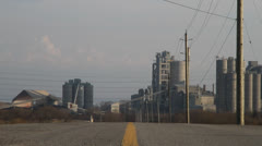 Road towards industrial plant, low angle. HD 1080p 24fps. Stock Footage