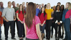 Happy, diverse group in casual clothing, isolated on white in a studio shot Stock Footage