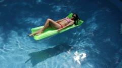 Floating Sunbather Stock Footage