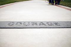 Courage text on the concrete walk Stock Photos