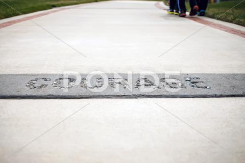 Stock photo of courage text on the concrete walk