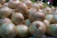 Onions on display at farmer's market Stock Photos