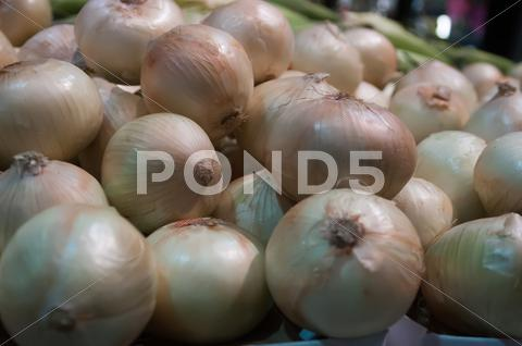Stock photo of onions on display at farmer's market