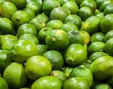 Green lemon  on display at farmers market Stock Photos