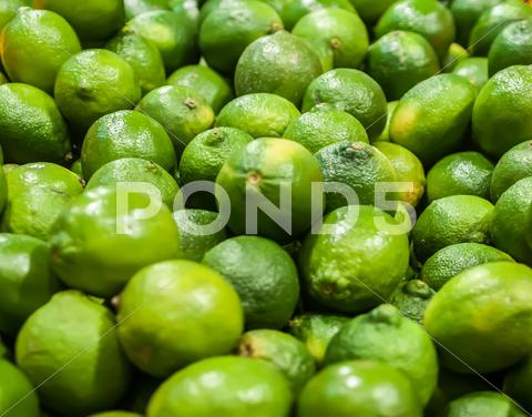 Stock photo of green lemon  on display at farmers market