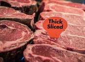 Thick sliced raw beef on display Stock Photos
