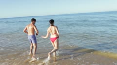 Couple Splashing One Another In Sea - stock footage