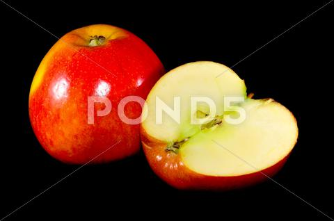 Stock photo of sliced apples on black background