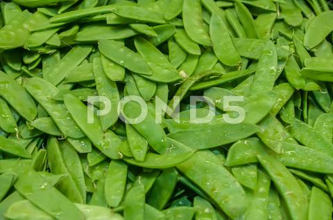 Stock photo of freshly harvested peas on display at the farmers market