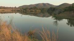 Nice lowlight reflection on dam Stock Footage