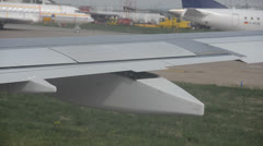 Stock Video Footage of Plane wing open flaps down