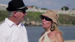 Senior people, sightseeing and travel, old man and woman walking and kissing Stock Footage