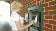 Stock Video Footage of Woman Using Cash Machine