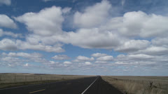 Lonely Highway and Clouds Time Lapse Stock Footage
