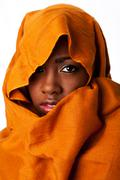 Mysterious female face in ocher head wrap Stock Photos