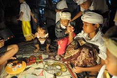 children participating to dice game Indonesia - stock photo