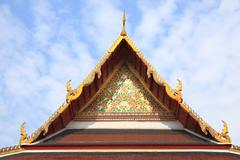 Gable of buddha church and wire screen for bird protect Stock Photos