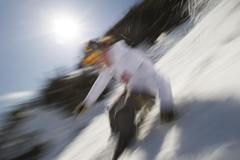 motion blurred image of an expert skier. - stock photo