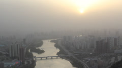 City air pollution under the sunset - stock footage