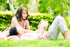 Couple relax ingarden Stock Photos