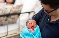 asian newborn baby and daddy - stock photo