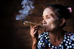 old asian woman smoking - stock photo