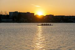 Rowing in the dusk Stock Photos