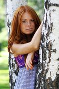portrait of red-haired beautiful young woman - stock photo